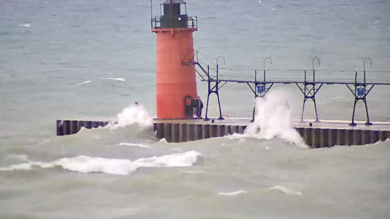 South Haven waves hit spectators on pier