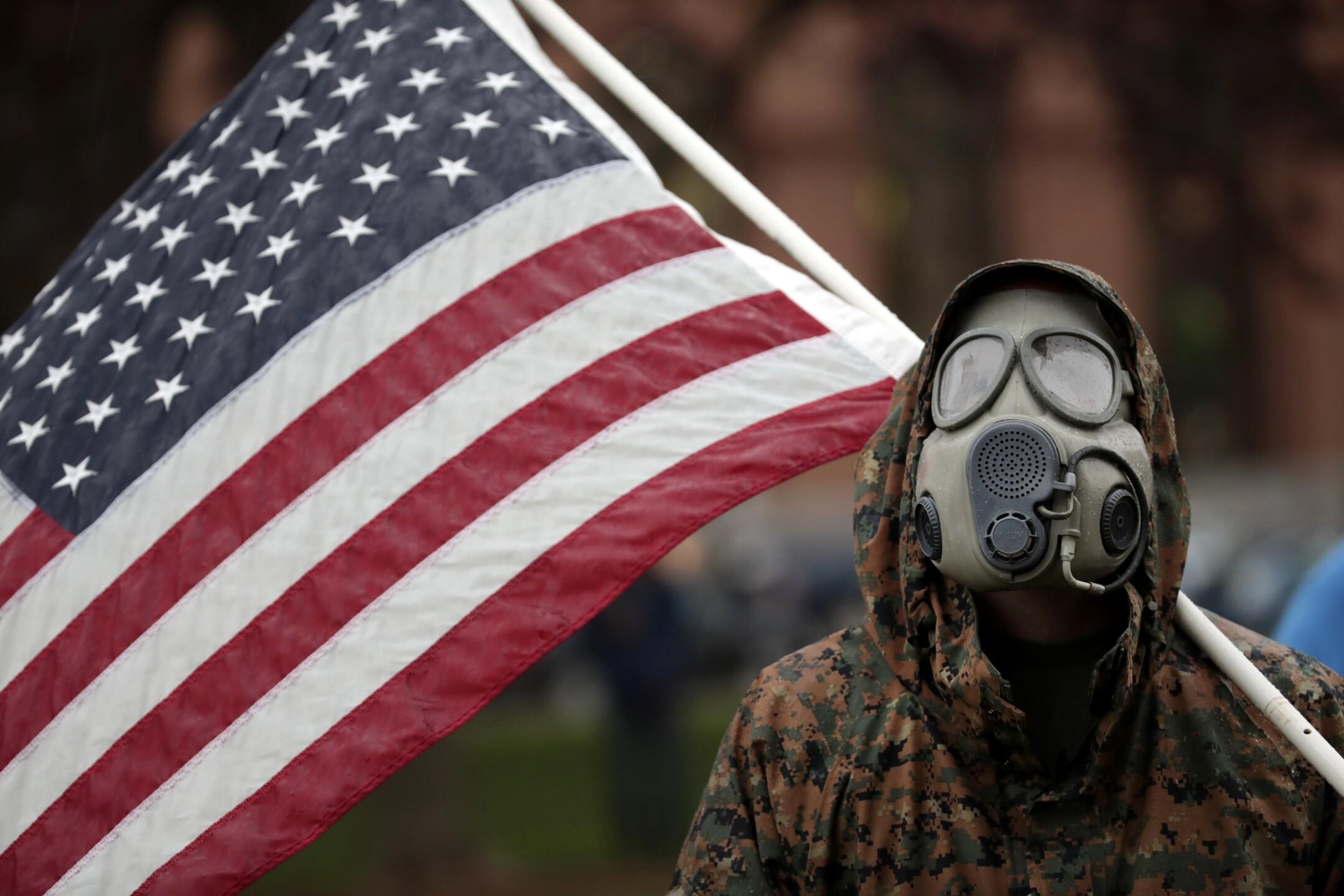 APTOPIX Virus Outbreak Michigan Protest