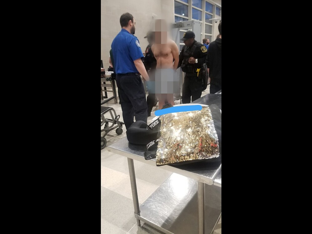 Naked man at DTW