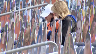 Broncos fans amid cutout