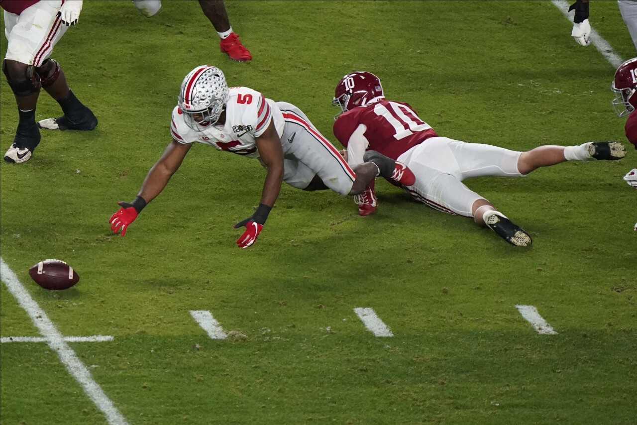 Ohio State Buckeyes linebacker Baron Browning recovers fumble by Alabama Crimson Tide QB Mac Jones in second quarter of 2020 College Football Playoff National Championship