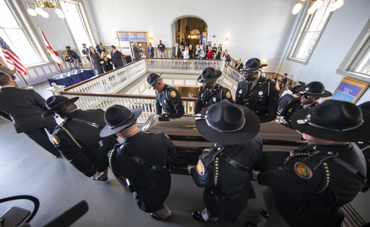 Florida Highway Patrol troopers carry casket of Bobby Bowden through old Florida Capitol, Aug. 13, 2021