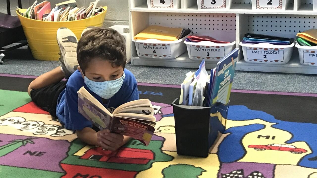 give a child a book winnwood elem.JPG