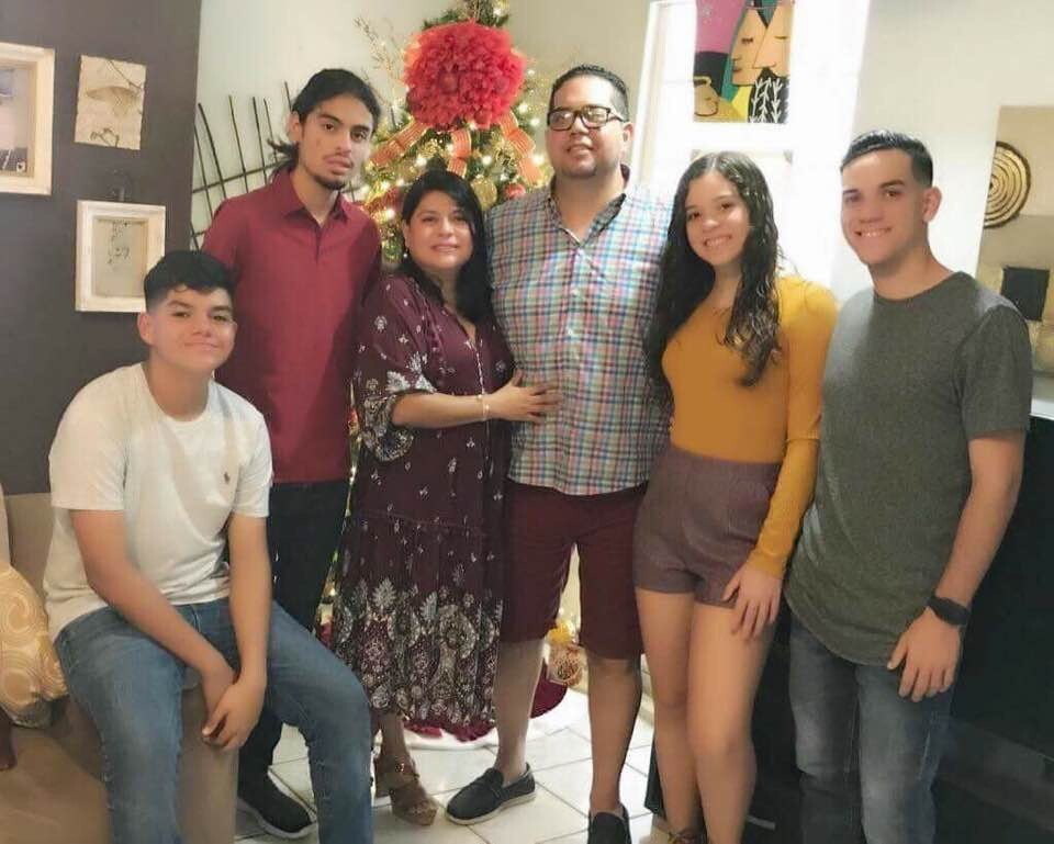 Felix Santa next to his family, pictured in Puerto Rico