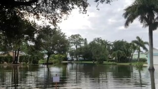 Flooding in the Sandcastle Circle neighborhood of Hobe Sound on May 26, 2020.