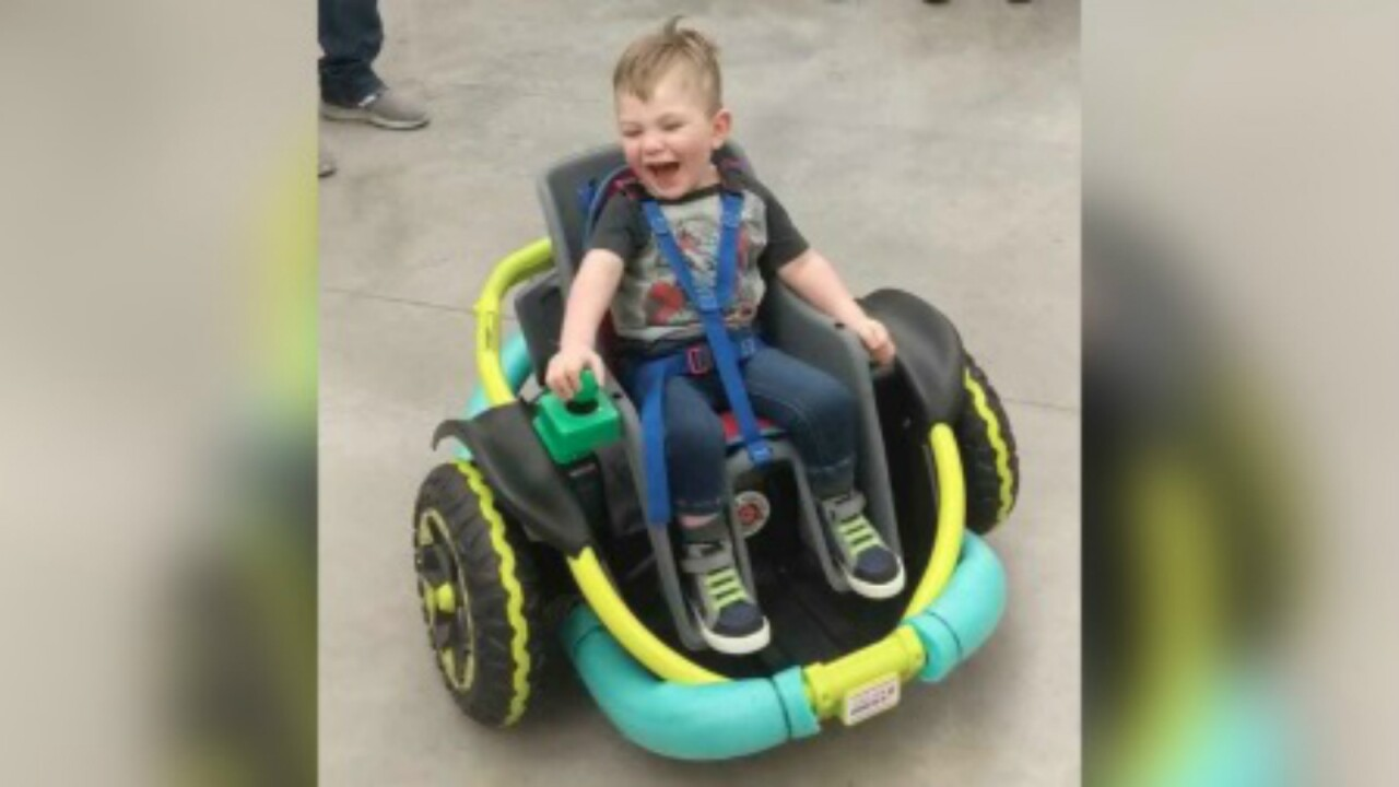 High school robotics team builds custom wheelchair for 2-year-old who can't walk