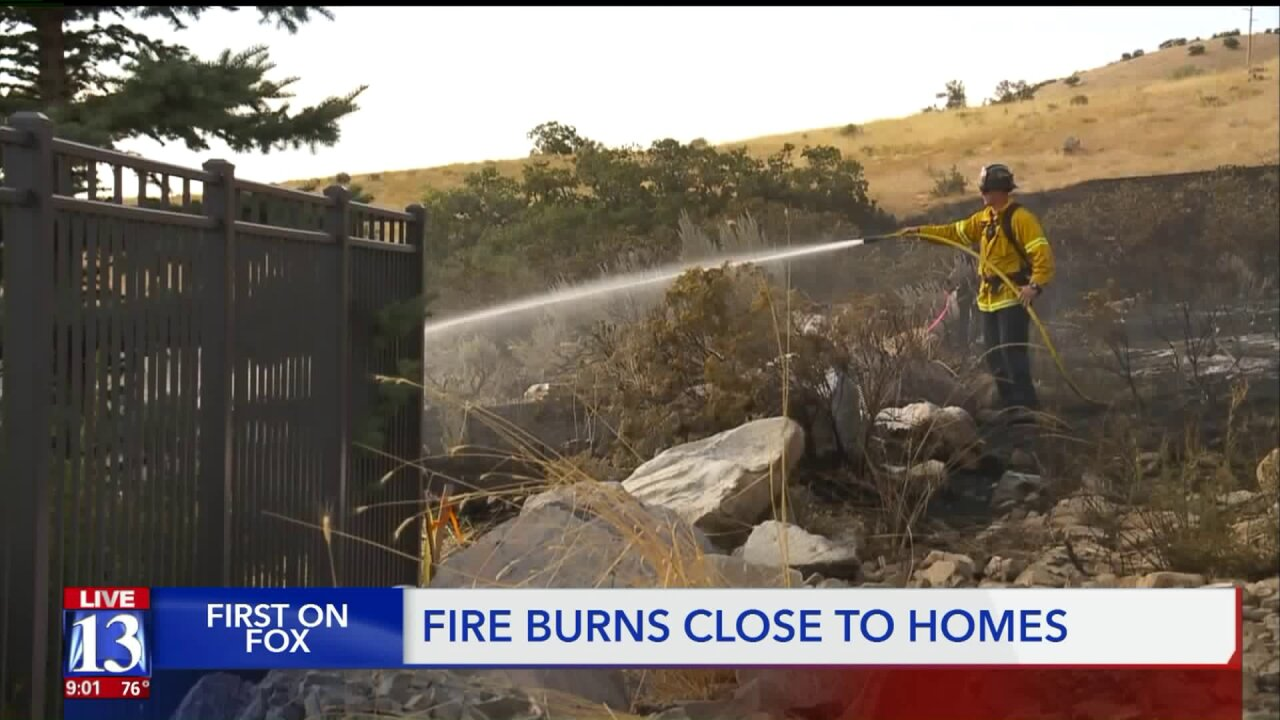 Wildland fire sparked by construction equipment approaches property lines inLindon