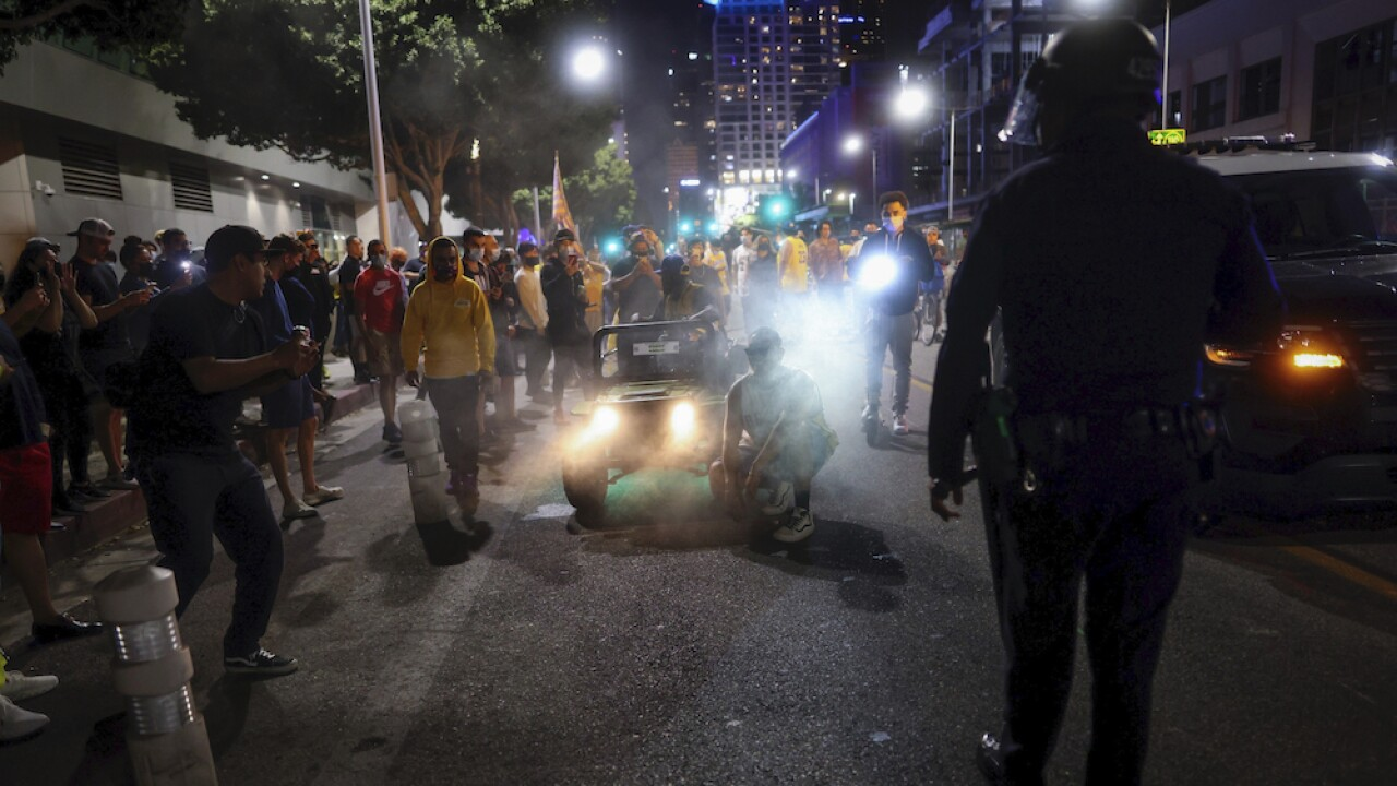 Lost teeth and an exploded eye: LAPD fired projectiles into crowd celebrating Lakers' win, 2 hurt