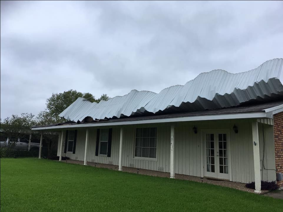 Metal peeling off a house's roof in St. Martinville. Courtesy Nia Cummings Ness.