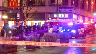 Police work the scene of a shooting on Third Avenue and Pine Street, Wednesday, Jan. 22, 2020, in Seattle. (Amanda Snyder/The Seattle Times via AP)