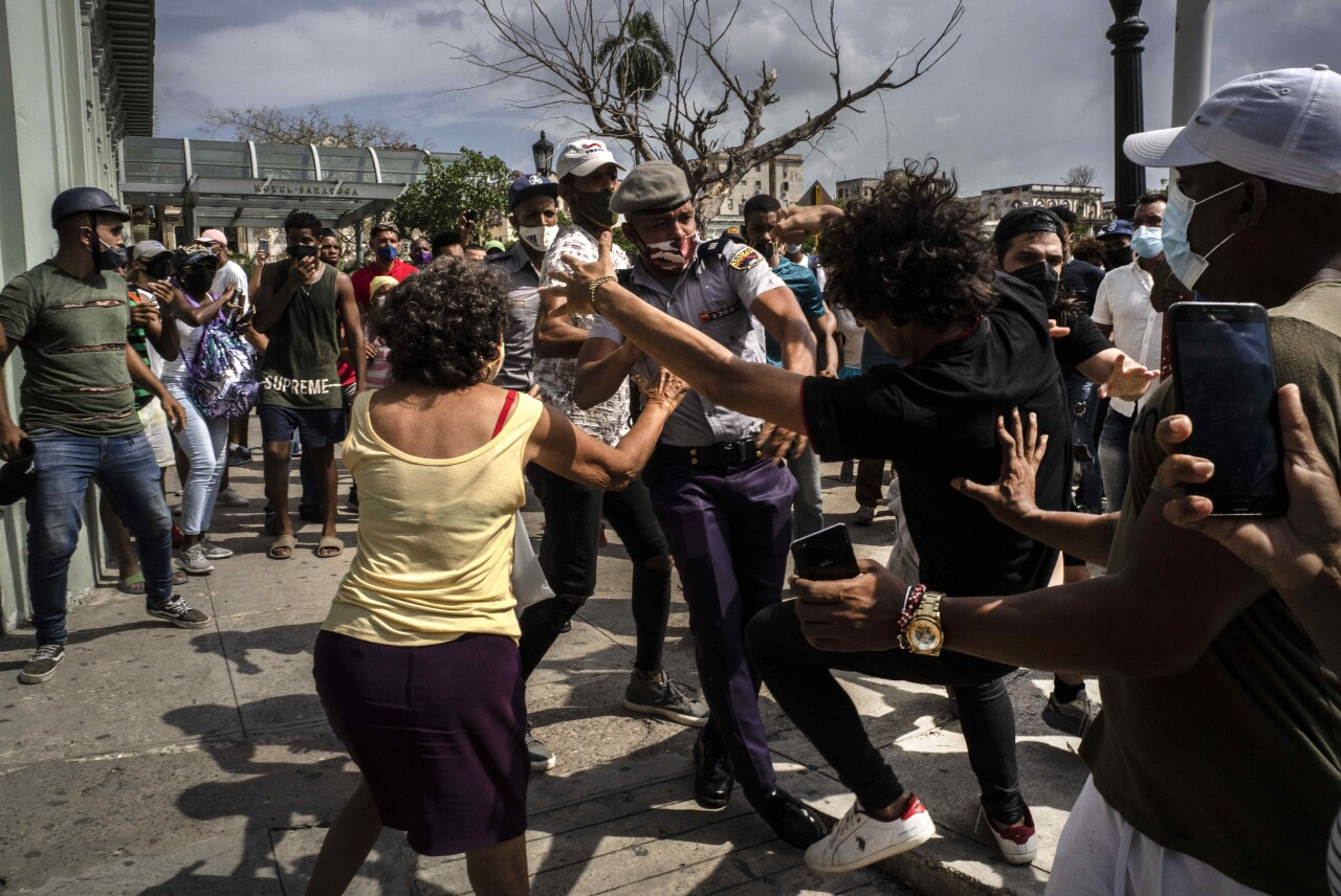 Police scuffle with anti-government demonstrator in Havana, Cuba, July 11, 2021