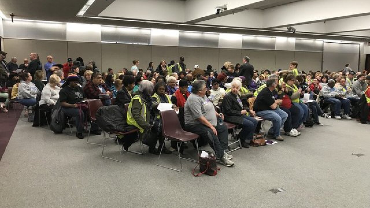 Crowds pack OPS meeting on paycheck changes