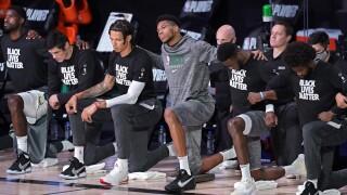 Milwaukee Bucks kneel