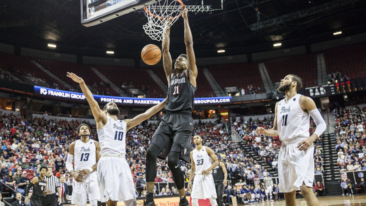 Aztecs decimate No. 22 Nevada, 90-73, advance to MW tournament championship