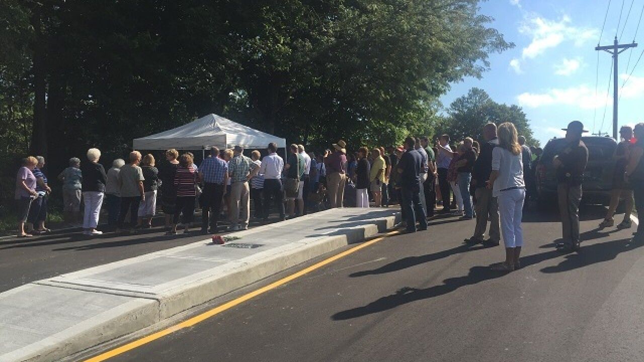 LOOK: Johnson Co. road reopens with grave site