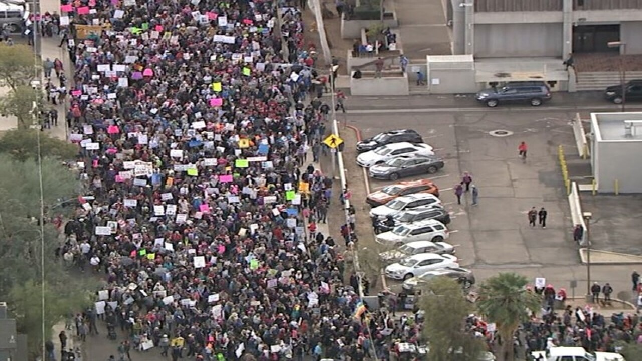 LIVE: Women descend on DC march, PHX to follow