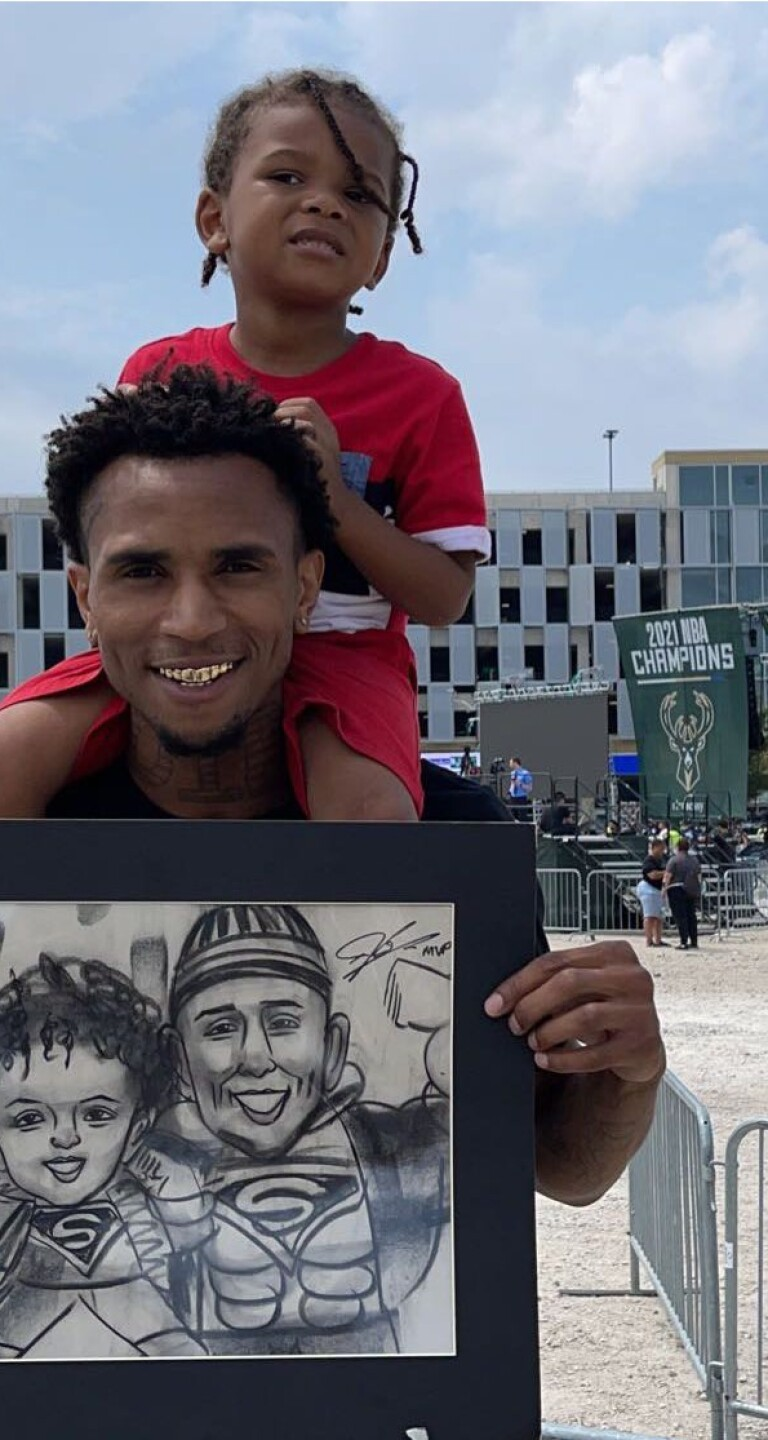 Bucks fan get picture signed by Giannis during the parade