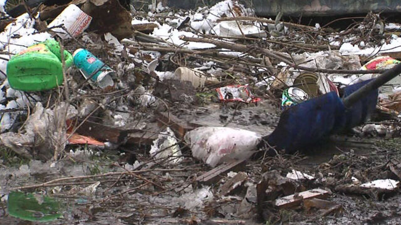 Trash dump in NE-side alley cleaned up
