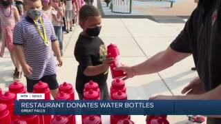 Great Falls business owner donates water bottles to students