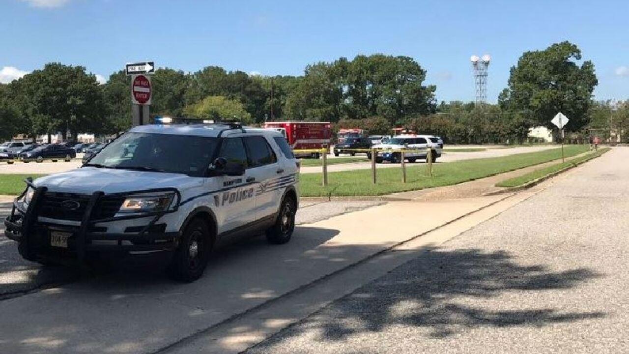 Man in custody after homicide near Hampton school parkinglot