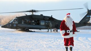 Santa, soldiers bring joy to town with river erosion crisis