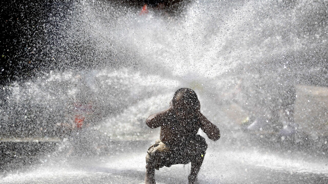 City fire hydrant open during hot weather