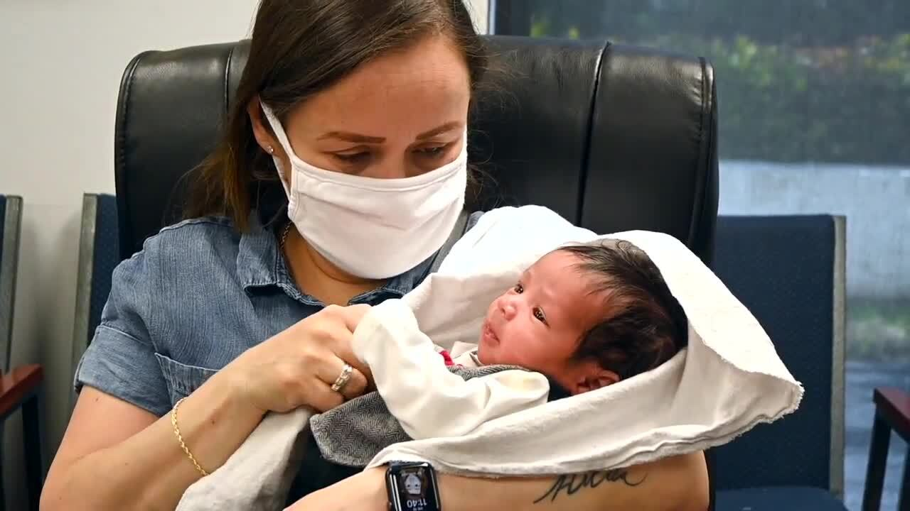 Emi Sira holds newborn son, whose father Demond Thomas died in crash
