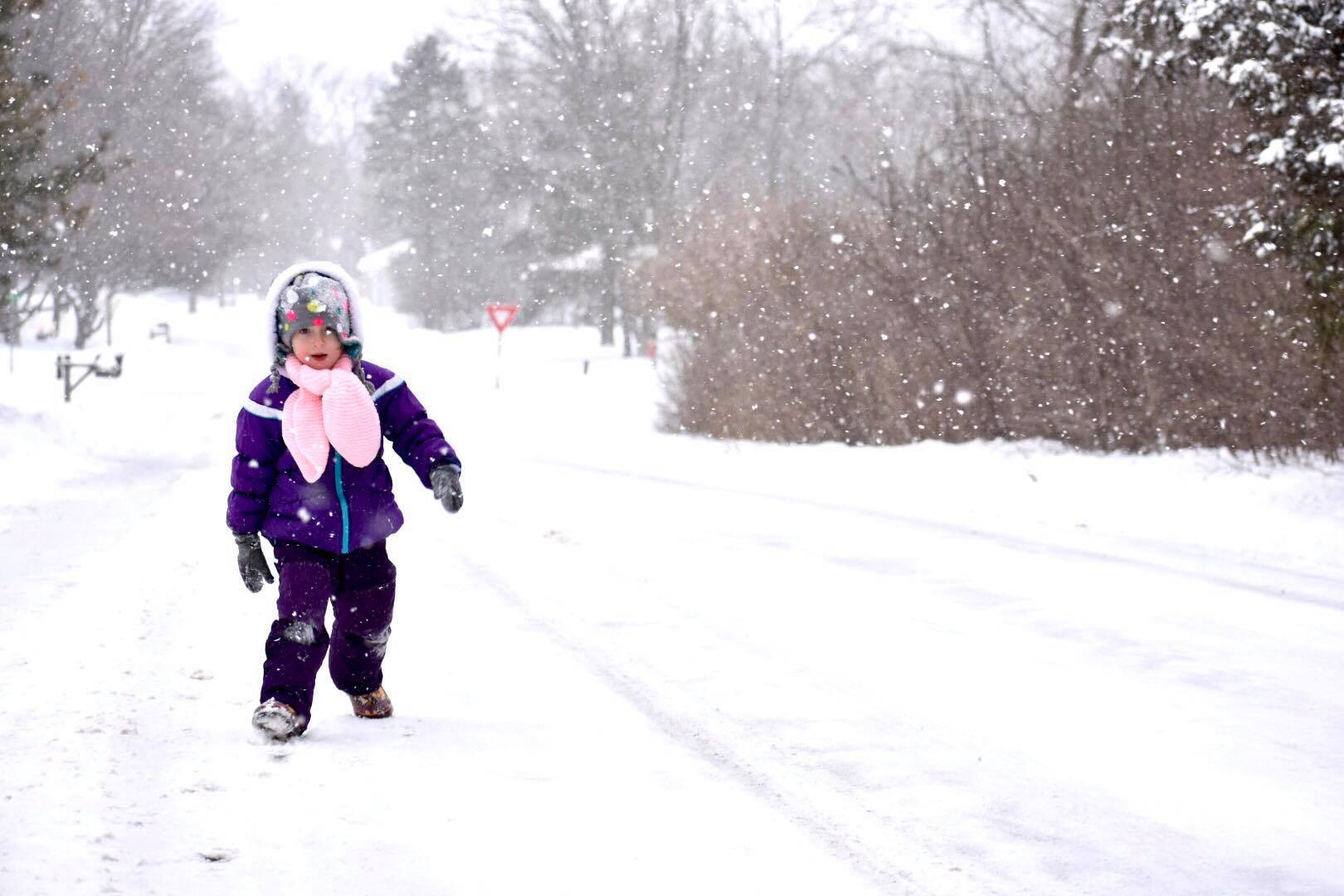 Child walking in the snow
