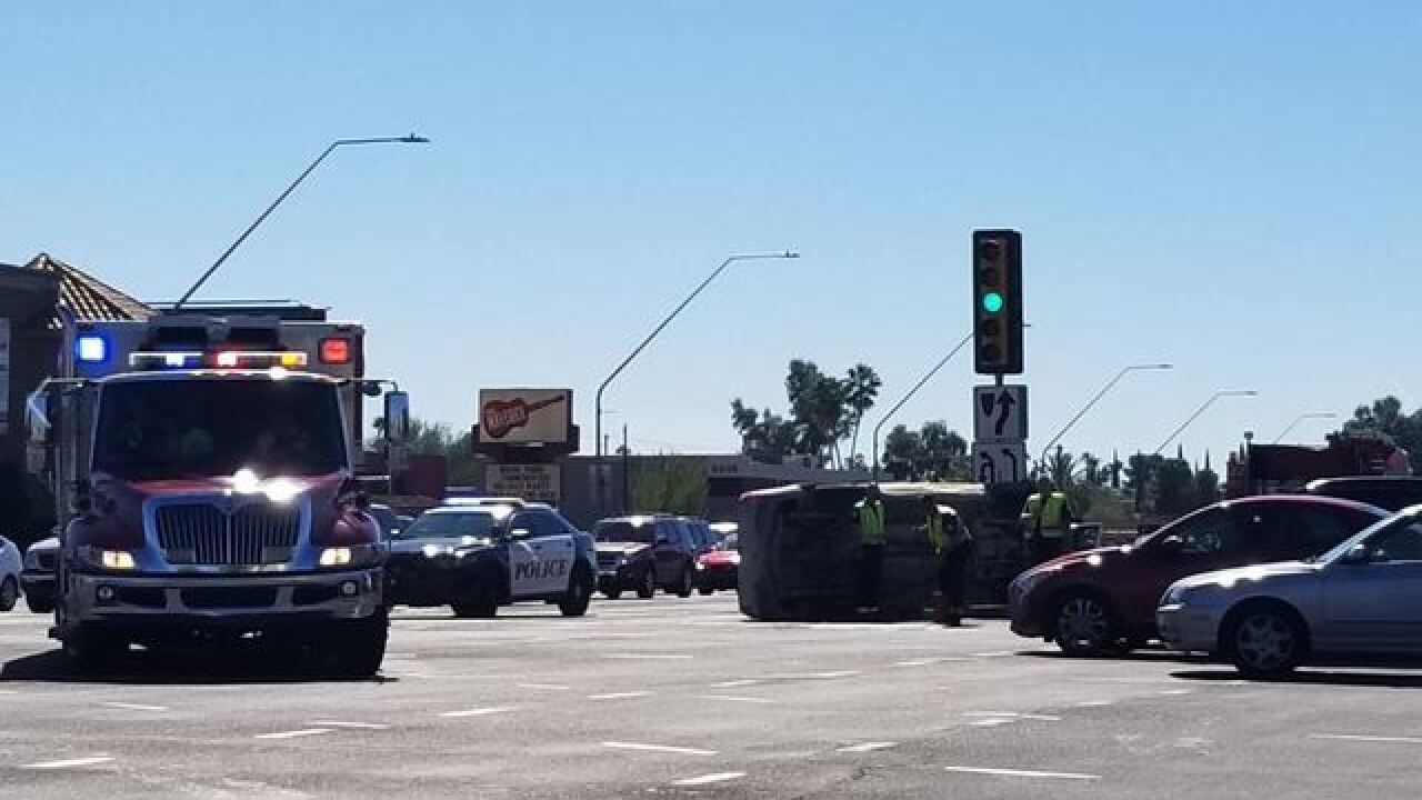 Tucson collision flips truck on its side