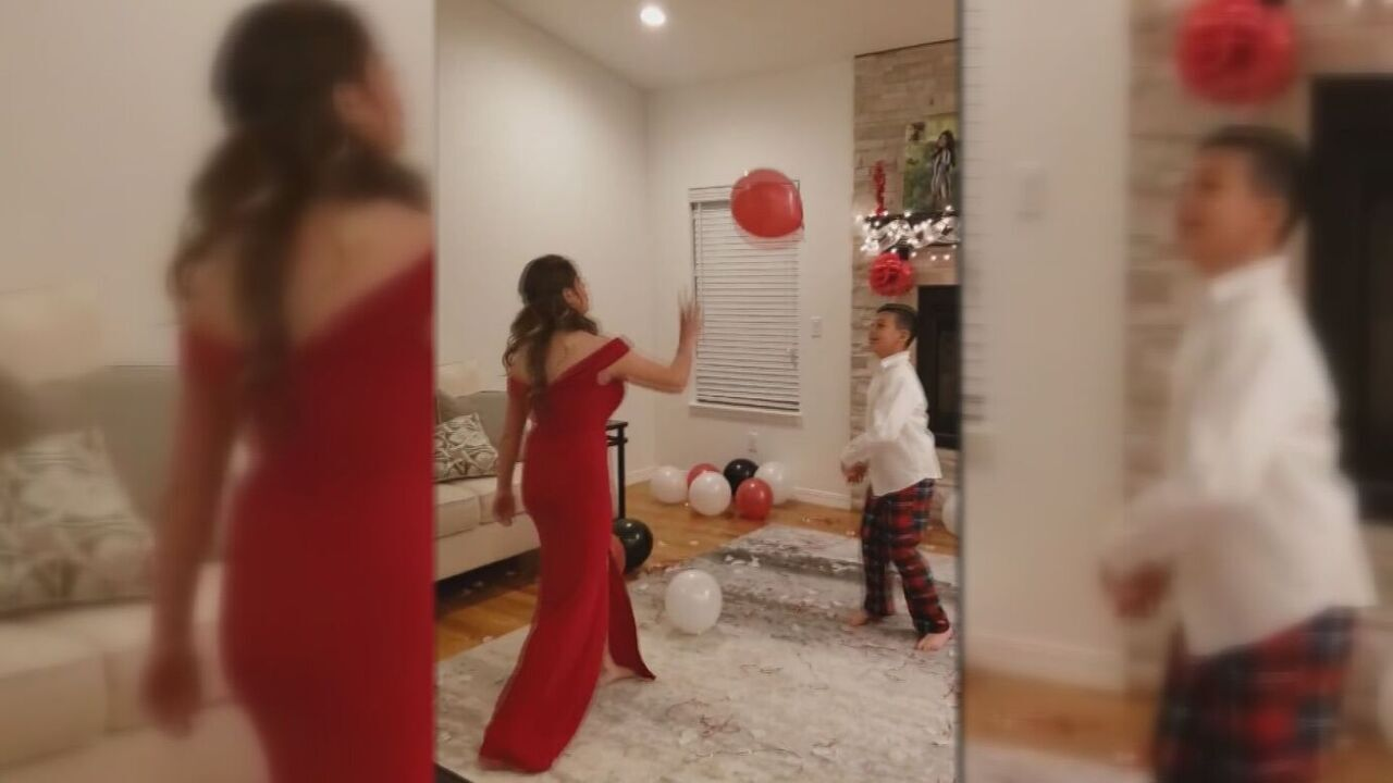18-year-old Jacelynn Trujillo and her nine-year-old brother Tyson Trujillo play with balloons at her 'home prom' celebration