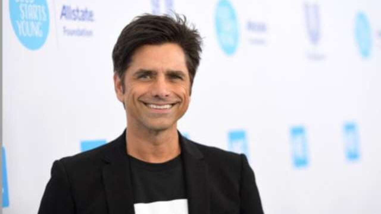 John Stamos shares first photo of son's face