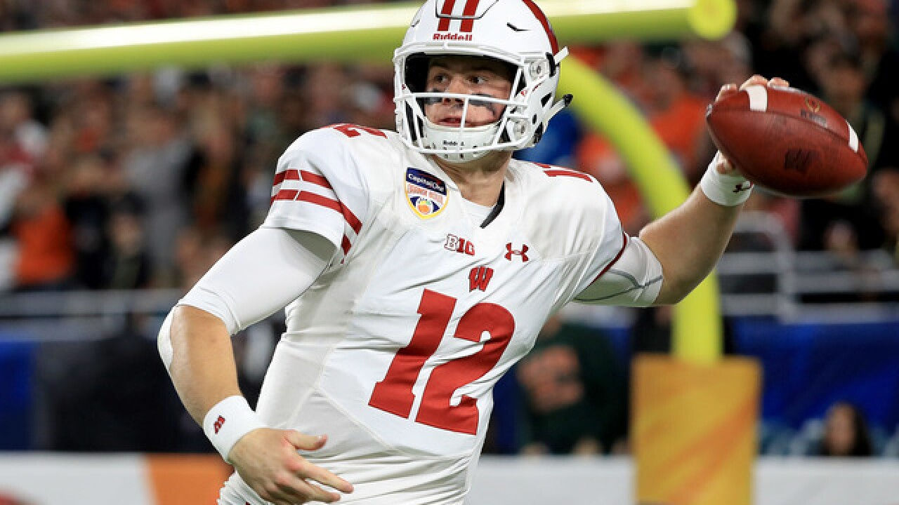 Hornibrook's 4 TDs carry Badgers past Miami, 34-24 in Orange Bowl