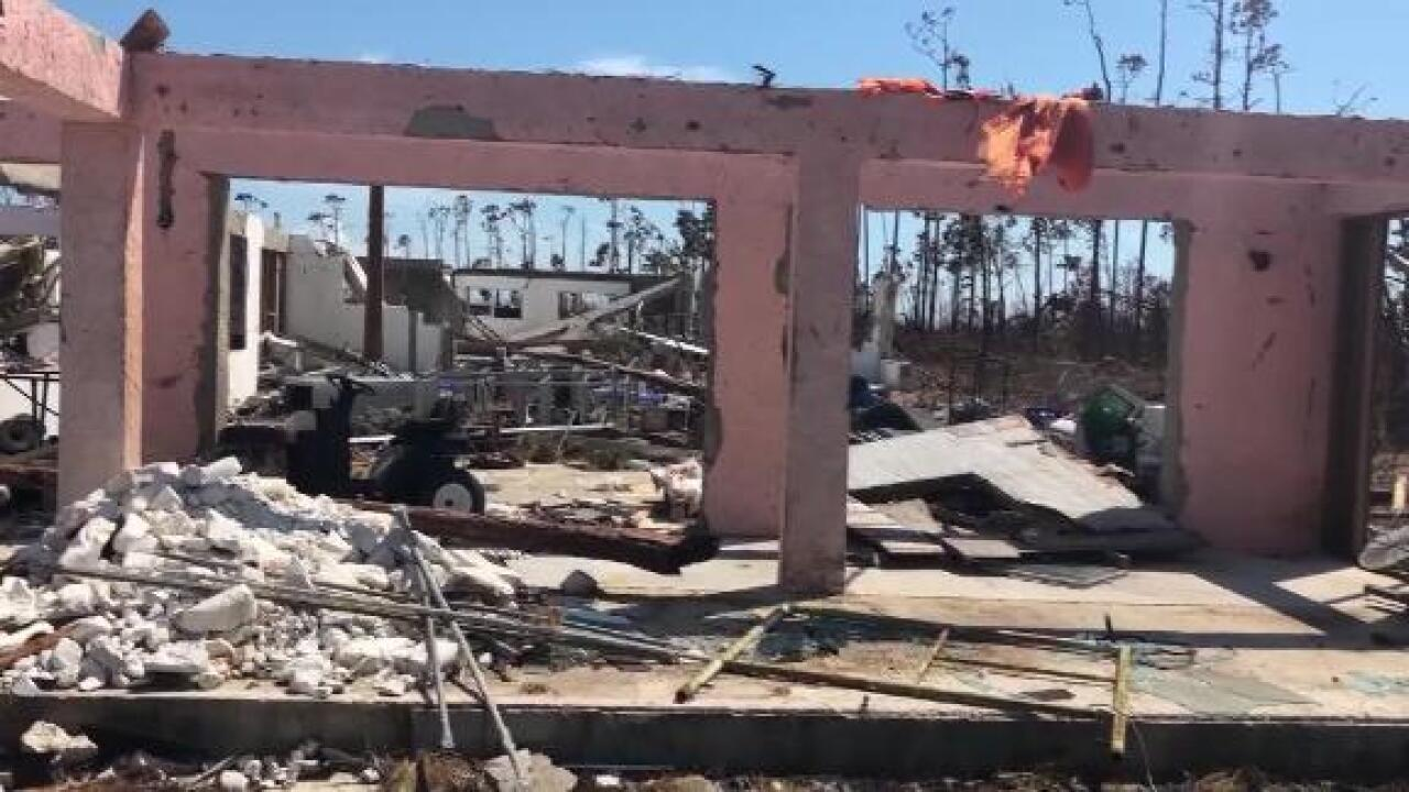 Piles of rubble and splintered homes are slowing down search efforts in the Bahamas