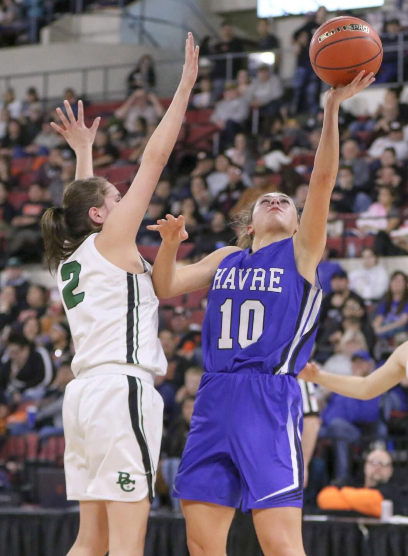 Kyndall Keller gets a shot under the basket as Maria Stewart defends.jpg