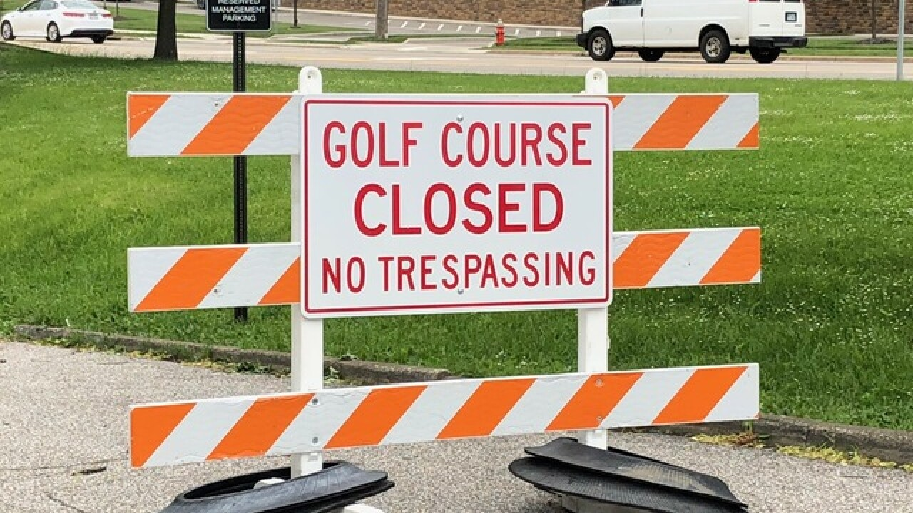 Cleveland frantically tries to open golf course