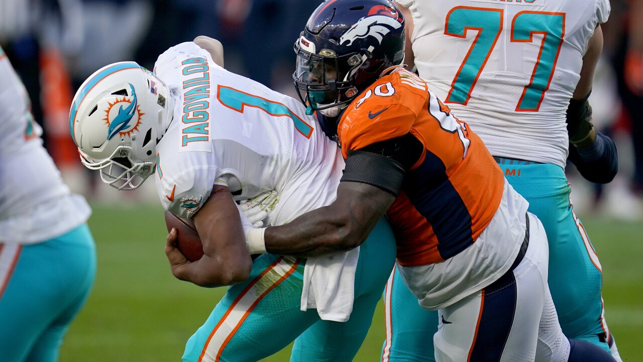 Miami Dolphins QB Tua Tagovailoa sacked by Denver Broncos defensive end DeShawn Williams in 2020