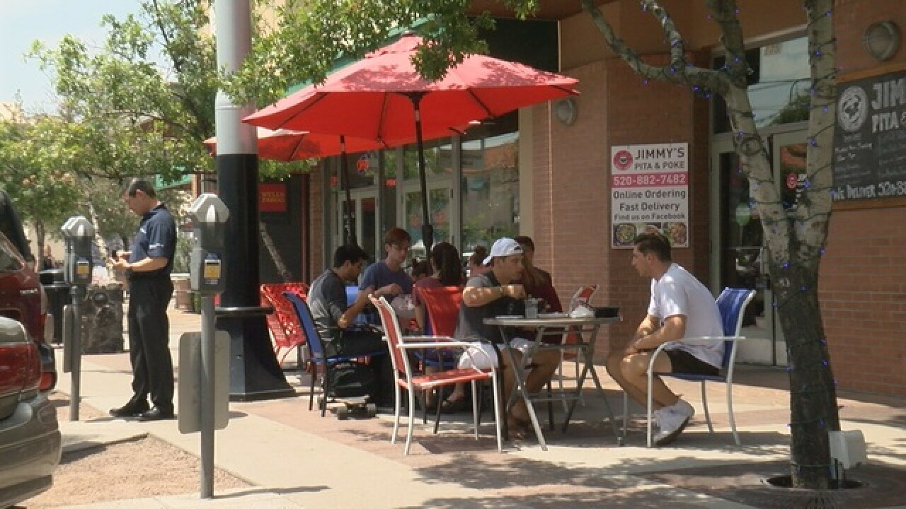 UA students return, bring business