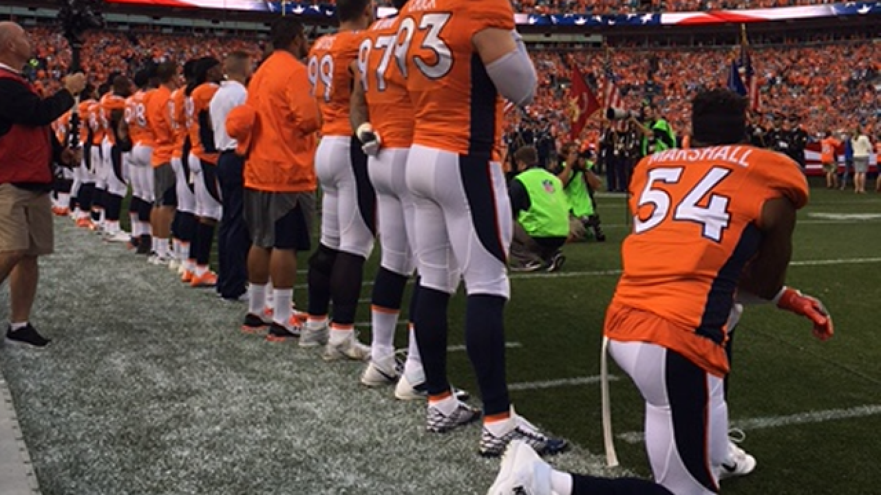 huge selection of 52a80 aade5 Broncos' Brandon Marshall kneels during national anthem