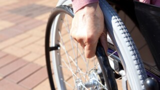 Woman in wheelchair hit by car while illegally crossing street
