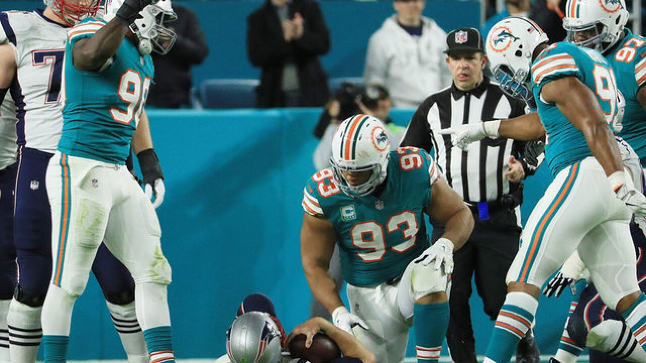 Tom Brady intercepted twice as Dolphins beat Patriots 27-20