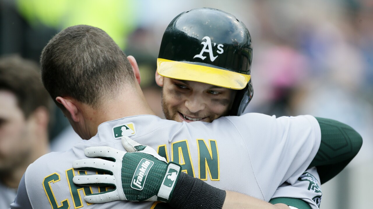 A's homer twice, beat Tigers for 15th straight time