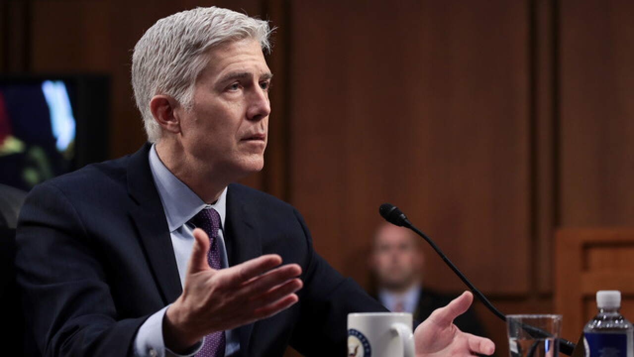 Supreme Court nominee unscathed facing last day of hearings
