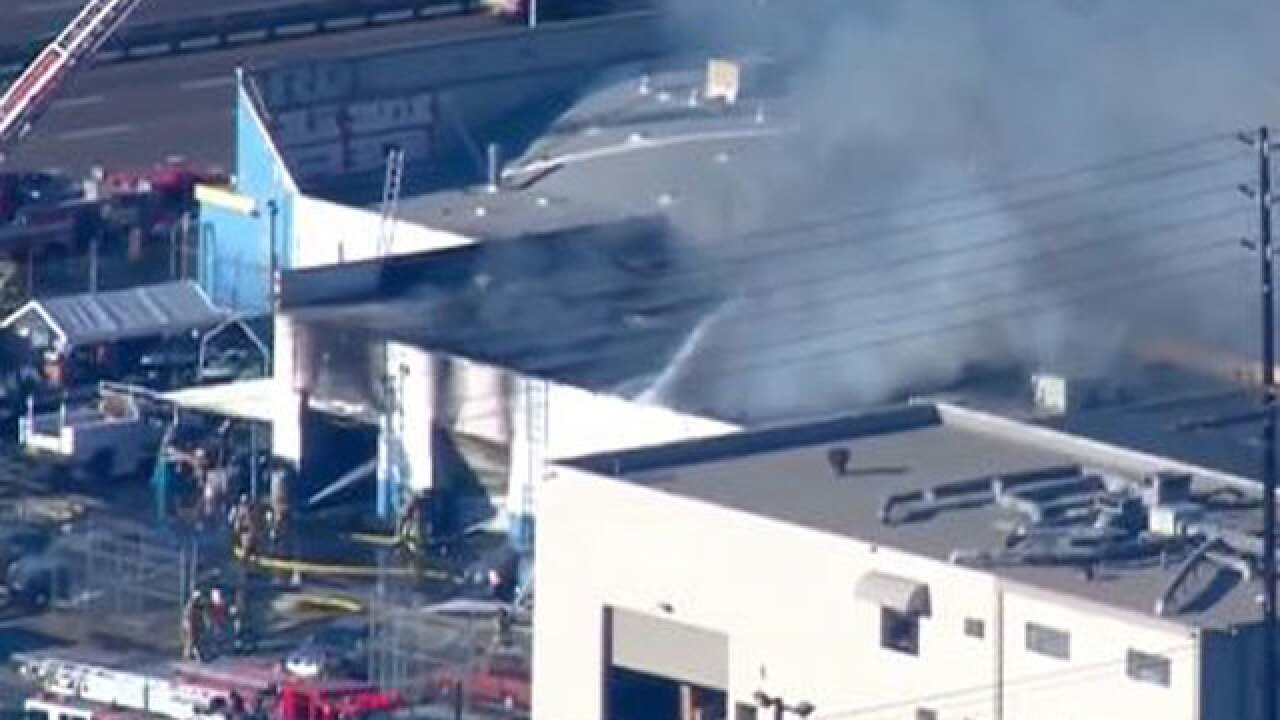 Fire erupts at auto body shop near SD airport