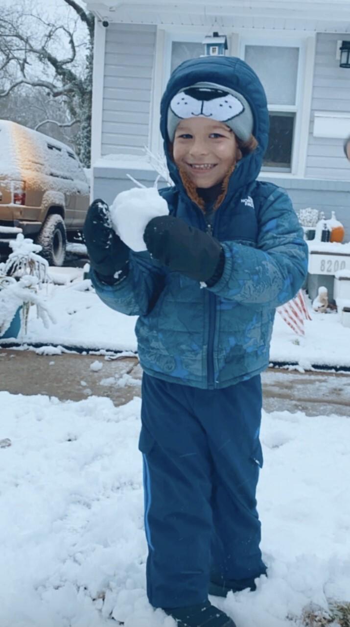My 3 year old grandson enjoying his first big boy snow.jpg