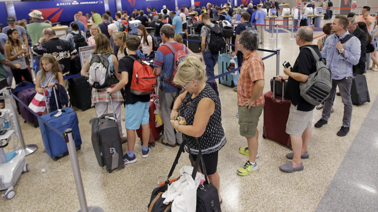 Delta cancels hundreds of Tuesday flights following Monday's mass outage