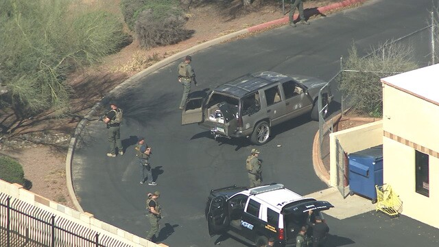 PHOTOS: Police search Avondale neighborhoods for shooting suspect