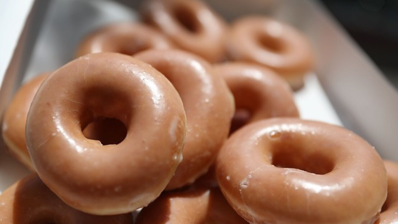 Krispy Kreme will give you a dozen doughnuts for $1 tomorrow, under one condition