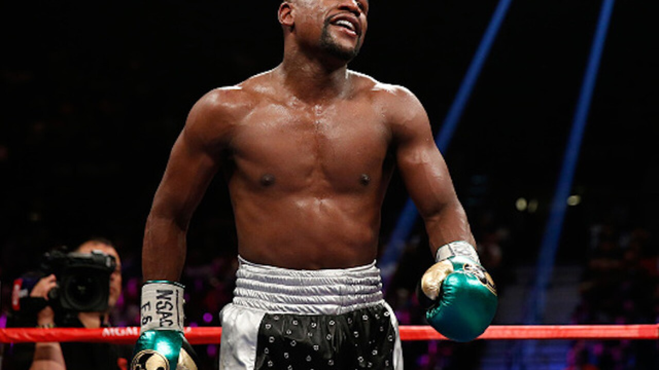 Mayweather wins in 10!