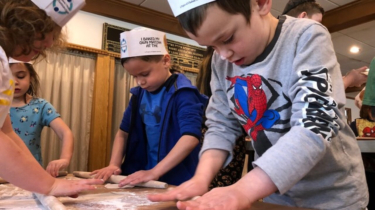 Kids with special needs bake at Matzah factory