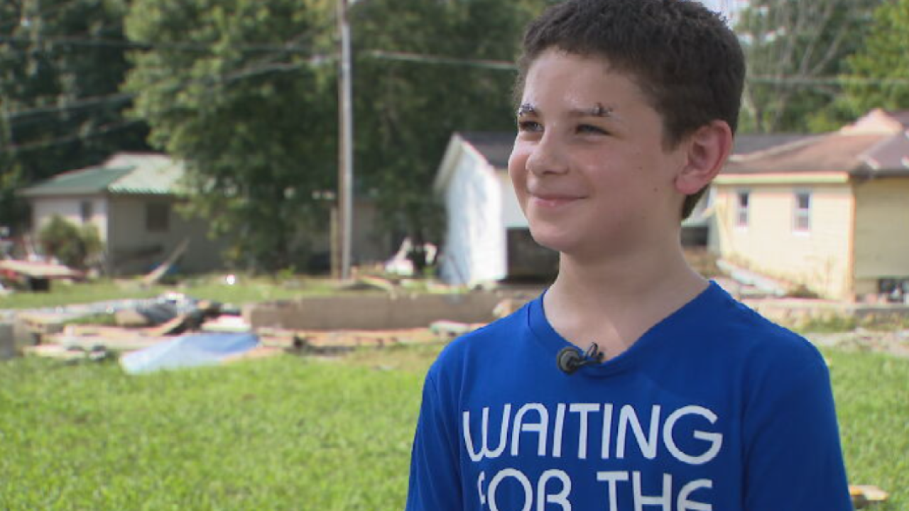 Ripped from his mother, 8-year-old boy survives Waverly flood on his own